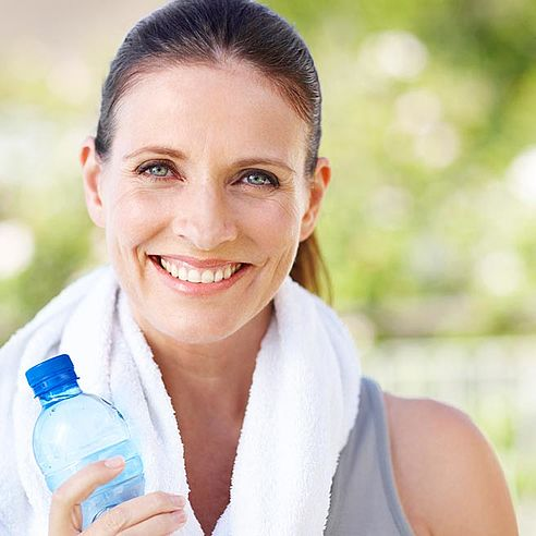 Woman with a drinks bottle doing sport